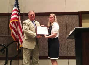 M McClam presenting Marty Mobley with NSPE Fellow